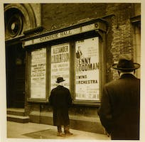 A man peruses the poster for Benny Goodman's concert outside Carnegie Hall, 1938