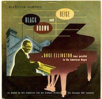 "Album cover for Duke Ellington's ""Black, Brown, and Beige"" depicting Ellington at a piano"