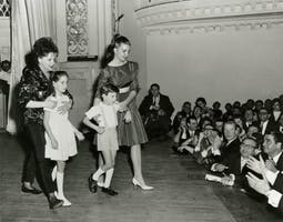 Judy Garland on stage at Carnegie Hall with her children Lorna Luft, Joey Luft, and Liza Minnelli