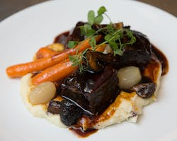 Braised Angus beef short rib, whipped parsnips, and roasted heirloom carrots
