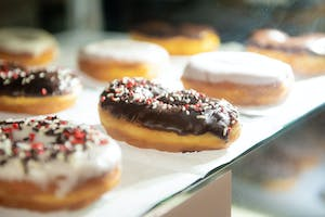 Donuts with chocolate and vanilla icing and black, white, and red sprinkles