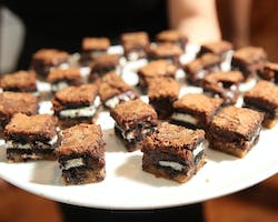 A platter of brownie Oreo cookie bars by Constellation Culinary Group