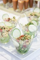 Stemless martini glasses of chick pea, cucumber, tomato, and feta salad