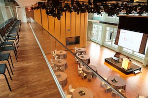 Fireside chat–style stage set and half-round guest seating seen from the Weill Music Room balcony