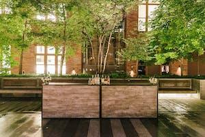 A wood-paneled bar awaits guests on the Weill Terrace after an evening rain