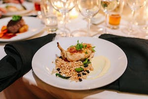 Roasted bone-in chicken with Israeli couscous, roasted asparagus, and potato parsnip purée