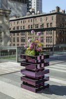 Purple mirrored square high top table on the Weill Terrace with colorful floral centerpiece