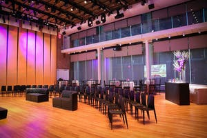Weill Music Room set for a program with sleek black seating, cocktail tables, and bar