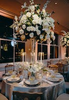 Elegant formal dining table with dramatic white floral arrangements in the Weill Terrace Room