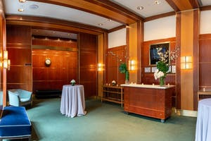 The Jacobs Room, elegantly appointed with wood paneling and soft seating