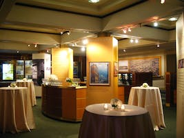 The Rose Museum and its brightly lit exhibit cases are ready for guests with a bar and high tables