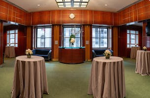 A wall of windows overlooking 57th Street in the Shorin Club Room, set for a reception