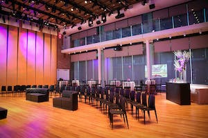 Weill Music Room set for a program with sleek black seating, cocktail tables, and guest bar