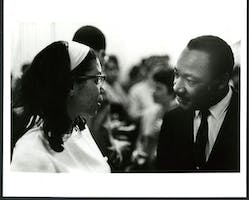 Dr. Martin Luther King with Mrs. DuBois-Peck, backstage at Carnegie Hall, February 23, 1968. Photo by Jim Hinton, courtesy of Norma Rogers/ Carnegie Hall Archives.