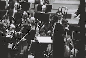 Isaac Stern joins Leonard Bernstein and the New York Philharmonic for the inaugural concert of the newly saved Hall's 1960–1961 season. When he appeared to perform Beethoven's Violin Concerto, the audience greeted Stern with a standing ovation, in recognition of his efforts to save the Hall from destruction. A moment of drama ensued when Stern's E-string snapped during the first movement of the concerto. Barely missing a beat, he swapped instruments with concertmaster John Corigliano, who restrung Stern's violin and returned it to him during an orchestral passage. Photo courtesy of the New York Philharmonic.