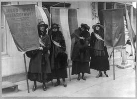 Suffragettes picketing in New York City, with banners advertising a meeting of the National Women's Party at Carnegie Hall on January 4, 1918.