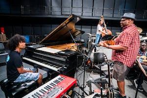 NYO Jazz pianist Miles Lennox with faculty member Reggie Thomas