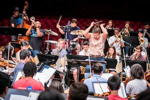 NYO-USA, NYO2, and NYO Jazz making music together with assistant conductor Deanna Tham
