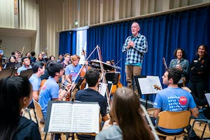 Orchestra Director Jim Ross with NYO-USA at a side-by-side rehearsal with RCO Young