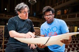 NYO-USA apprentice composer Tyson J. Davis talks with Sir Antonio Pappano