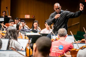 Resident Conductor Joseph Young rehearses with NYO2
