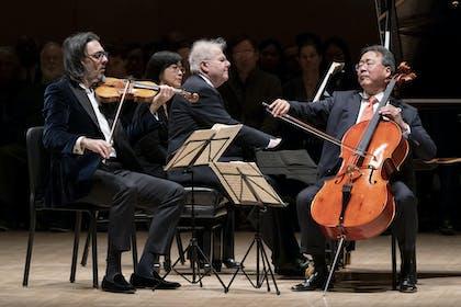 Leonidas Kavakos, Emanuel Ax, and Yo-Yo Ma mid-performance.