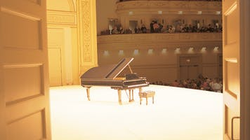A grand piano on Perelman Stage in Carnegie Hall's Stern Auditorium as seen from the stage door