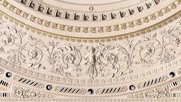 Detail of the embossed decorations on the ring of lights in Stern/Perelman at Carnegie Hall