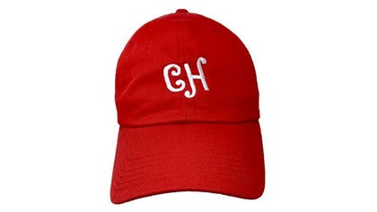 """A red baseball cap monogrammed in white: """"CH"""""""