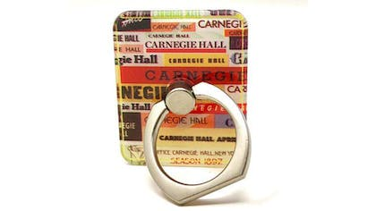 """A mobile phone ring holder decorated with various versions of the """"Carnegie Hall"""" logo"""