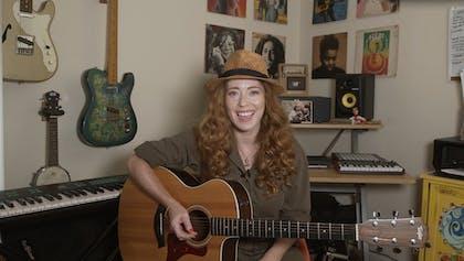 Bridget Barkan with a guitar