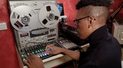 Charles Burchell uses an audio sampler to create a loop.