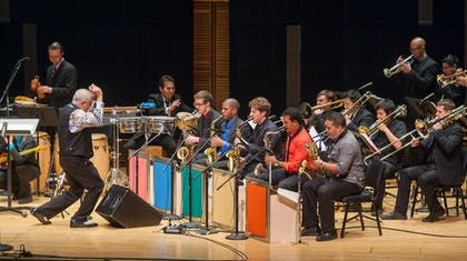 Paquito D'Rivera conducts members of his ensemble and workshop participants in a concert.
