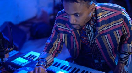 Asante in front of a keyboard with blue lighting