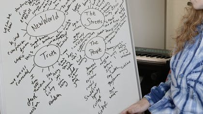 Bridget outlines the themes of her song on a whiteboard.