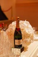 A bottle of champagne by Julie Skarratt