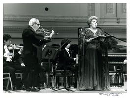 Marilyn Horne and Isaac Stern acknowledge applause during Carnegie Hall's Gala Reopening, December 15, 1986. This concert celebrated the reopening of the hall following extensive interior renovations that began the previous May.