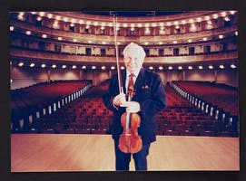 Isaac Stern photographed on stage during the making of the documentary, Carnegie Hall: A Place of Dreams, in 1990.