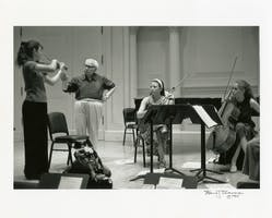 Isaac Stern works with the Cambiata String Quartet during a Carnegie Hall Professional Training Workshop.